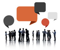 Silhouettes of Business People Discussing with Speech Bubbles Royalty Free Stock Photo