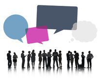 Silhouettes of Business People Discussing with Speech Bubbles Royalty Free Stock Images