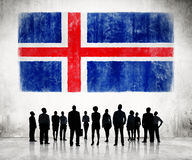 Silhouettes of Business People and a Flag of Iceland Royalty Free Stock Images