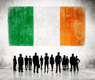 Silhouettes of Business People and a Flag of Ireland Royalty Free Stock Photo