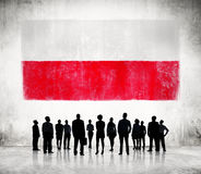 Silhouettes of Business People and a Flag of Poland Stock Photos