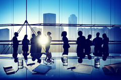 Silhouettes of Business People Gathered Inside the Office Royalty Free Stock Image