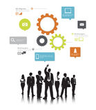 Silhouettes of Business People and Gears Stock Photo