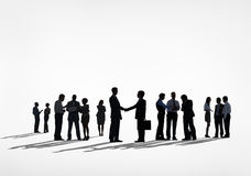 Silhouettes of Business People Handshake royalty free stock image