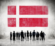 Silhouettes of Business People Looking at the Danish Flag Royalty Free Stock Images