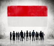 Silhouettes of Business People Looking at the Indonesian Flag Stock Photos