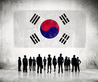 Silhouettes of Business People Looking at the South Korean Flag Stock Image