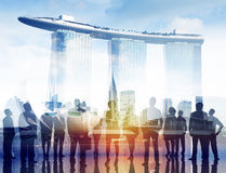 Silhouettes of Business People and Marina Bay Stock Photo