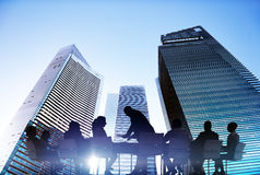 Silhouettes of Business People Meeting Outdoors Stock Photos