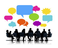 Silhouettes of Business People Meeting with Speech Bubbles Royalty Free Stock Photo