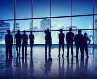 Silhouettes of Business People in an Office Building Royalty Free Stock Photo