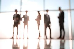 Silhouettes of Business People in Office. Mixed media . stock photography