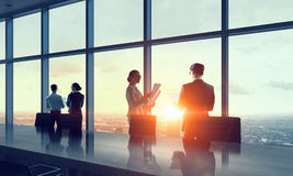 Silhouettes of Business People in Office. . Mixed media stock image