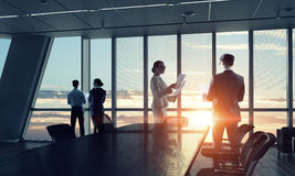 Silhouettes of Business People in Office. Mixed media . Mixed media stock photography