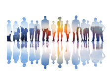 Silhouettes of Business People Overlaid with Cityscape Royalty Free Stock Photo