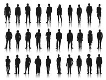 Silhouettes of Business People in a Row Stock Photos