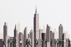 Silhouettes of business people with skyscraper building on backd Stock Photo