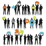 Silhouettes of Business People with Teamwork Concept Stock Photo
