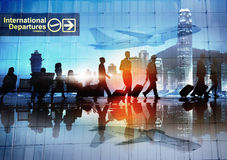 Silhouettes of Business People Walking in an Airport.  Stock Photography