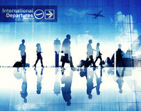 Silhouettes of Business People Walking in an Airport Stock Image