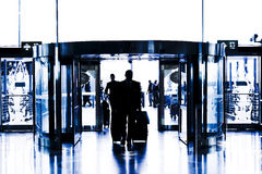 Silhouettes of business people walking in airport Stock Photography