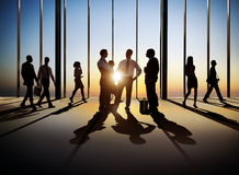 Silhouettes of  Business People Walking and Discussing Stock Photography