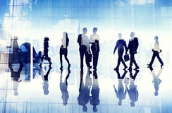 Silhouettes of Business People Walking inside the Office Royalty Free Stock Images