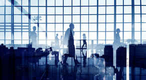 Silhouettes of Business People Walking Inside the Office.  Stock Images