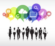 Silhouettes of Business People Walking with MultiColored Speech Bubbles stock illustration
