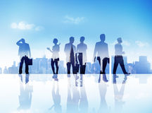 Silhouettes of Business People Walking Outdoors.  Royalty Free Stock Photos