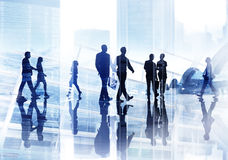 Silhouettes of Business People Wallking Inside the Office Royalty Free Stock Image