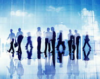 Silhouettes of Business People Working in an Office Royalty Free Stock Images