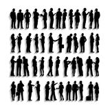 Silhouettes of Business People Working in a Row royalty free stock images