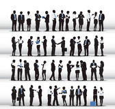 Silhouettes of Business People Working in a Row Royalty Free Stock Photos