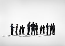 Silhouettes of Business People Working Together Royalty Free Stock Image