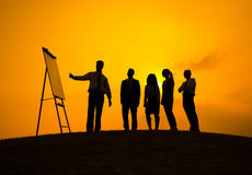 Silhouettes of Business Presentation Outdoors Royalty Free Stock Photos