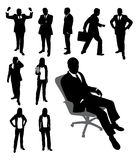 Silhouettes of businessman and businesswomen. Royalty Free Stock Image