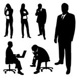 Silhouettes of businessman and businesswomen. Stock Image