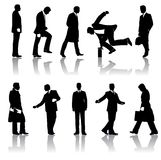 Silhouettes of businessmen. A set of silhouettes of business men with reflections Stock Images