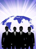Silhouettes of businessmen against a planet Royalty Free Stock Photography