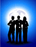 Silhouettes of businessmen against a planet Royalty Free Stock Photos