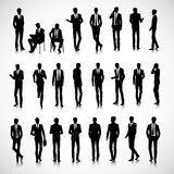 Silhouettes of businessmen. Set of business men silhouettes on background Stock Photos