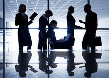 Silhouettes of businesspeople Stock Photos