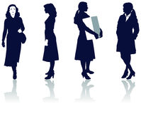 Silhouettes of businesswomen. Black and white illustrated silhouettes of businesswomen in various poses.  Also in vector format Stock Photography