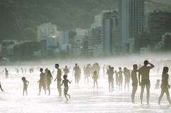 Silhouettes of Carioca Brazilians Standing Ipanema Beach Sunset Royalty Free Stock Photos