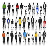 Silhouettes of Casual People in a Row Royalty Free Stock Photos