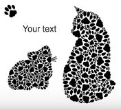 Silhouettes of cats from cat tracks Royalty Free Stock Images