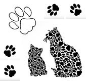 Silhouettes of cats from paws Royalty Free Stock Photography