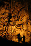 Silhouettes in the cave. Family in the cave - silhouettes Royalty Free Stock Photography
