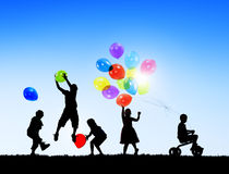 Silhouettes of Cheerful Children Stock Photos